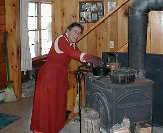 Mom tends the wood stove
